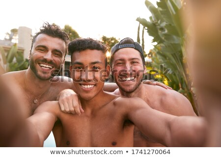 Three lads relaxing at home Stock photo © photography33