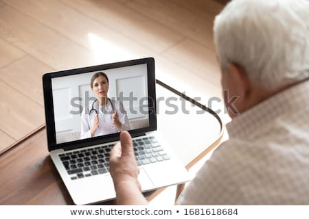 Man  helping elderly woman with computer problems Stock photo © photography33