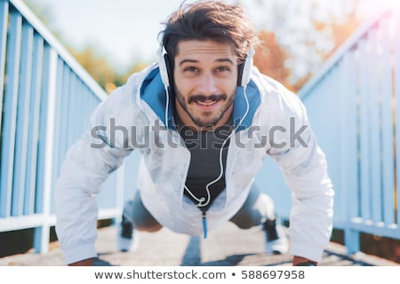 young man doing fitness in a park Stock photo © photography33