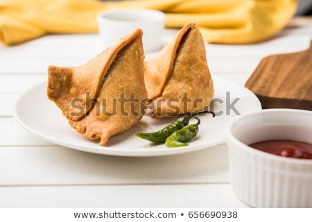 Popular indian deep fried snack called samosa Stock photo © mnsanthoshkumar