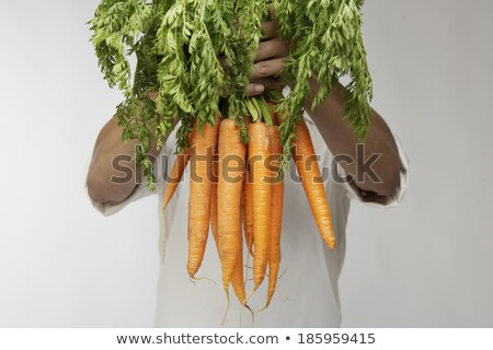 chef holding a bunch of carrots stock photo © photography33