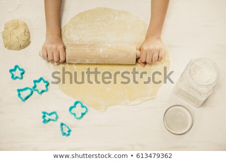 young woman with rolling pin adding flour to dough stock photo © rob_stark