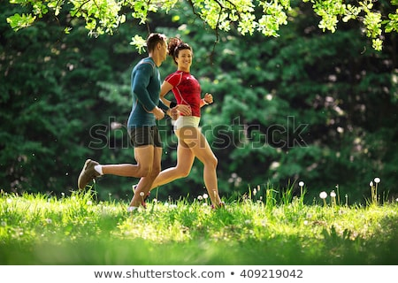 young couple jogging outdoors in spring nature stock photo © candyboxphoto