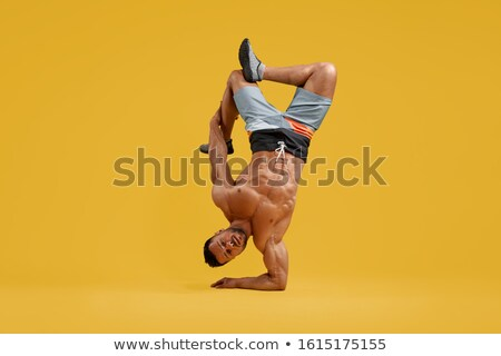 Sportsman is standing on hand for coordination stock photo © vetdoctor