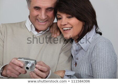 Married couple looking at photographs taken on digital camera Stock photo © photography33