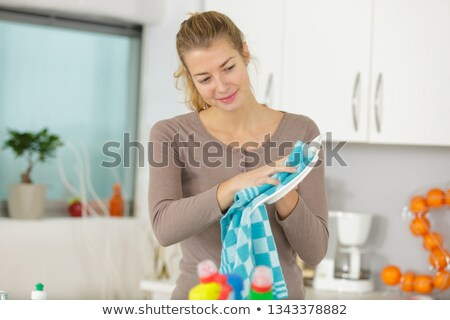 laughing blond woman drying dishes stock photo © wavebreak_media