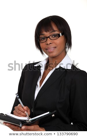 Eager businesswoman writing in her diary Stock photo © photography33