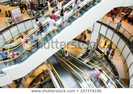 people in motion in escalators at the modern shopping mall stock photo © arcoss