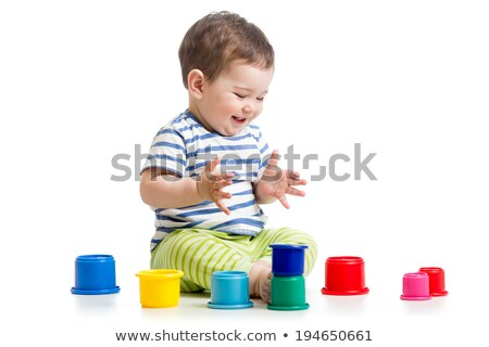 Funny little kid playing with toys, isolated over white  stock photo © dacasdo
