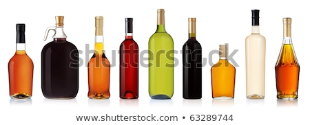Liquor bottle with a full shot glass Stock photo © Zerbor