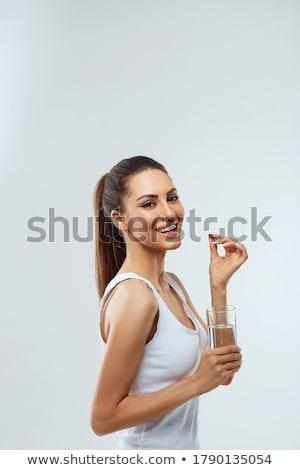 holding pills stock photo © lighthunter