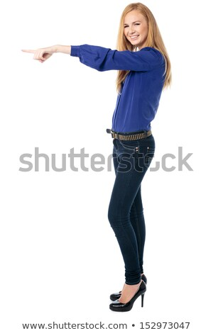 Stylish smiling woman pointing ahead of herself Stock photo © fantasticrabbit