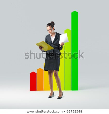 Stock photo: Woman with energy consumption sign