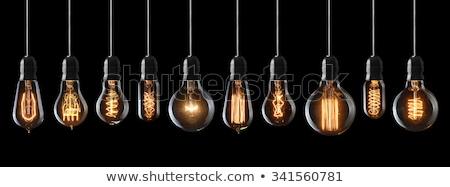 Light bulb on black background, reflection Stock photo © pxhidalgo