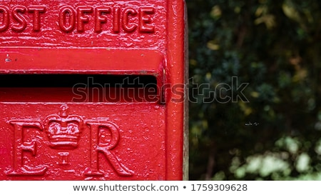 Close up of a British red post box, with a white background. Stock photo © latent