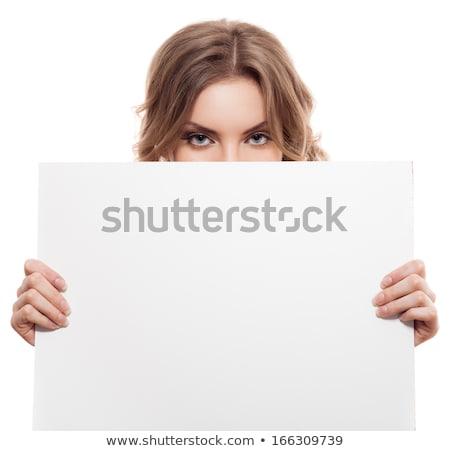 Beautiful elegant blond holding a blank white sign Stock photo © dash