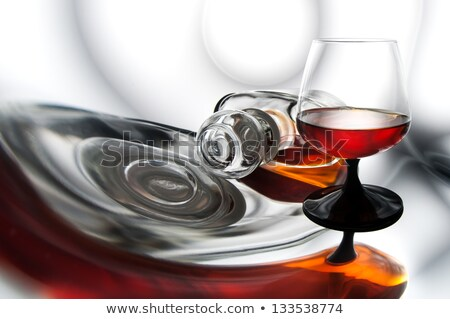 glass of cognac in a distorted reflection Stock photo © RuslanOmega