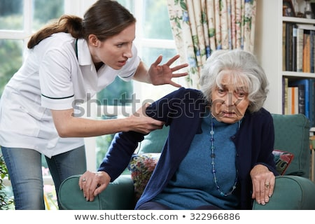 Care Worker Mistreating Senior Woman stock photo © HighwayStarz