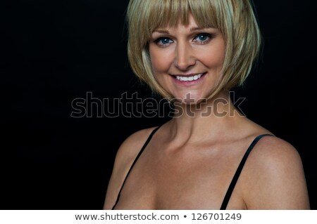 middle aged woman in spaghetti top stock photo © stockyimages