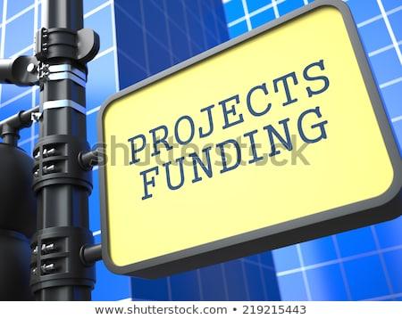 Projects Funding. Signpost on Blue Background. Stock photo © tashatuvango