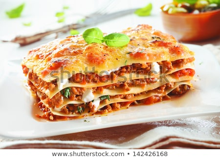 Italian Food. Lasagna plate with fresh basil. Stock photo © dariazu