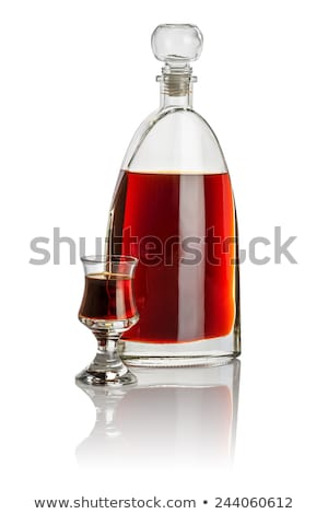 Carafe and drinking glass filled with brown liquid Stock photo © Zerbor