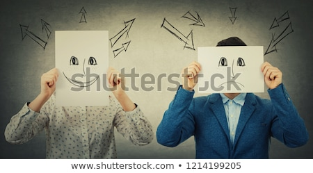 Businesswoman covering her face with angry mask Stock photo © ichiosea