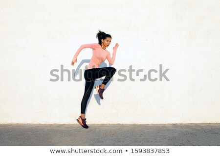 Stock photo: Young fitness woman jumping high