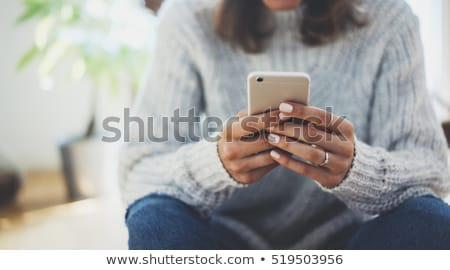 closeup image of a woman using smartphone stock photo © deandrobot