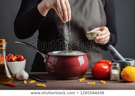 Woman At Home Adding Salt To Meal Stock photo © HighwayStarz