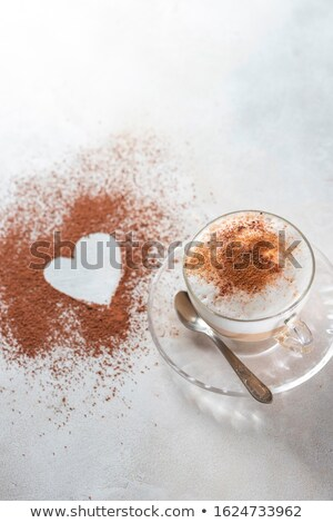 cup with espresso coffee with cinnamon and two candies isolated  Stock photo © tetkoren