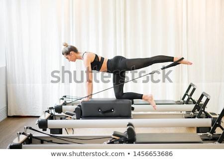 Pilates woman in reformer exercise at gym Stock photo © lunamarina