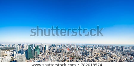 High-rise buildings on blue sky with clouds Stock photo © cherezoff