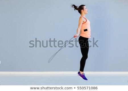 Fitness girl with skipping rope Stock photo © bezikus