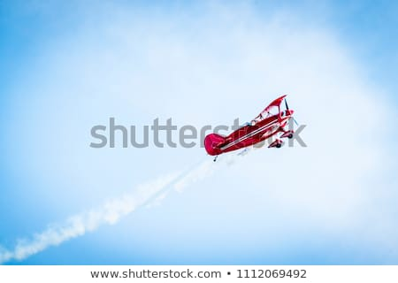 A red vintage plane with a pilot Stock photo © bluering