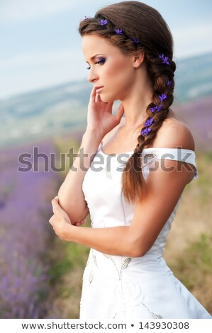 beautiful brunette bride posing in lavender field in the summer stock photo © victoria_andreas