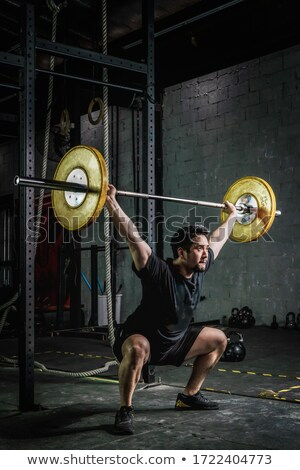 Stock photo: Man with barbell.