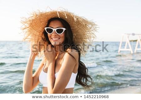 Alluring young woman walking on the summer beach Stock photo © konradbak