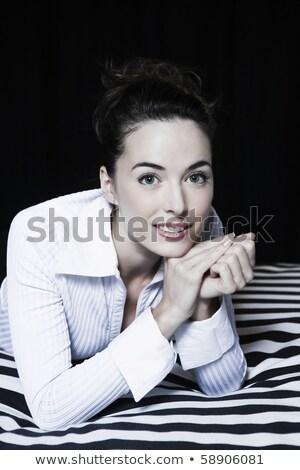 Alluring brunette posing in the hotel's room Stock photo © konradbak