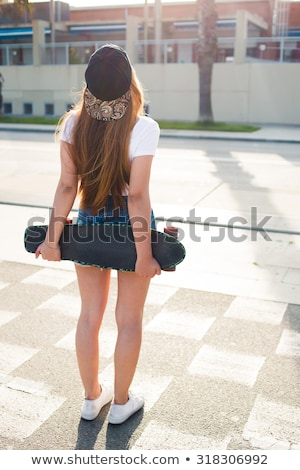 Back view image of young sports lady Stock photo © deandrobot