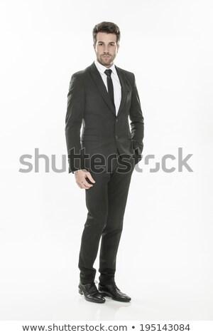 Kibirli genç işadamı takım elbise yalıtılmış beyaz Stok fotoğraf © gsermek