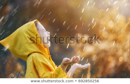 child under autumn rain stock photo © choreograph