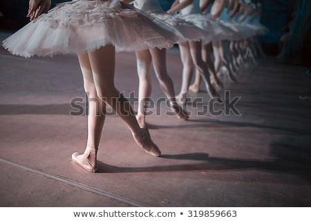 Stock photo: The close-up feet of young ballerinas in pointe shoes