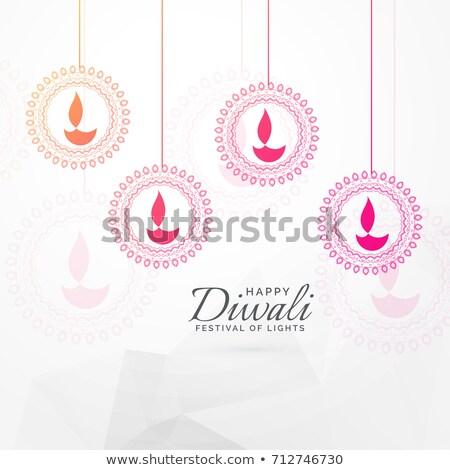 creative diwali festival greeting card design with hanging diya  Stock photo © SArts
