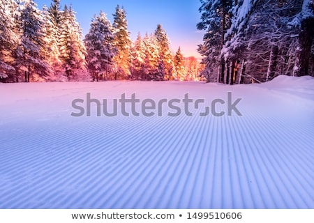 Stock photo: Groomed ski run track in snow