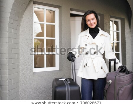 Woman holding suitcases on the patio Stock photo © IS2