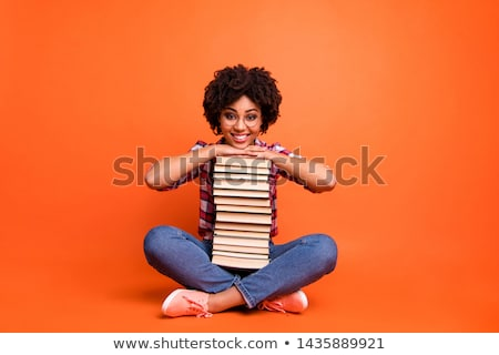 School girls holding stacks of books stock photo © IS2