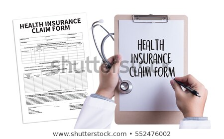 insurance forms on office binder blurred image stock photo © tashatuvango