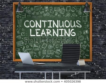 hand drawn continuous learning on office chalkboard stock photo © tashatuvango