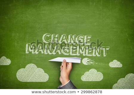 change management on chalkboard in the office stock photo © tashatuvango